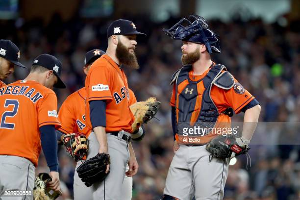 Dallas Keuchel of the Houston Astros speaks to Brian McCann during the fifth inning against the New York Yankees in Game Five of the American League...