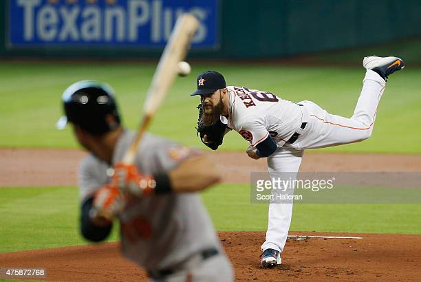 Dallas Keuchel of the Houston Astros throws a pitch in the first inning to Chris Davis of the Baltimore Orioles during their game at Minute Maid Park...