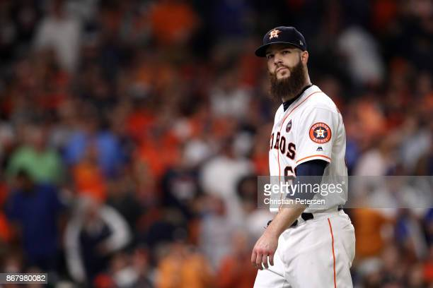 Dallas Keuchel of the Houston Astros walks off the field as he exits the game during the fourth inning against the Los Angeles Dodgers in game five...