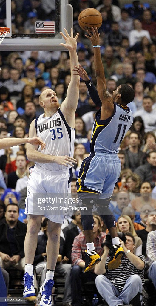Dallas Mavericks center Chris Kaman (35) tries to block a shot by Memphis Grizzlies point guard Mike Conley (11) during the second quarter at the American Airlines Arena in Dallas, Texas, Saturday, January 12, 2013.