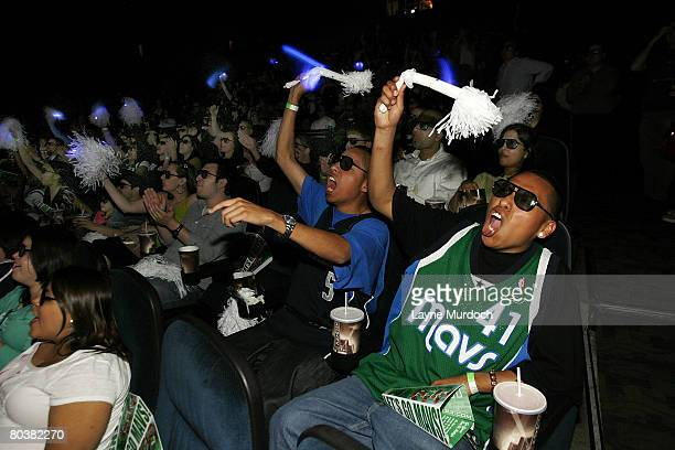 Dallas Mavericks fans Ivan Hernandez and brother Dario cheer for their team as they play the Los Angeles Clippers in 3D HD on March 25 2008 at the...