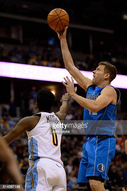 Dallas Mavericks forward David Lee takes a shot over Denver Nuggets guard Emmanuel Mudiay March 6 2016 at Pepsi Center