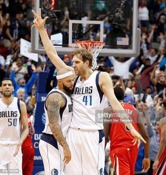 Dallas Mavericks forward Dirk Nowitzki celebrates his threepointer with guard Deron Williams left during overtime on Sunday March 20 at the American...