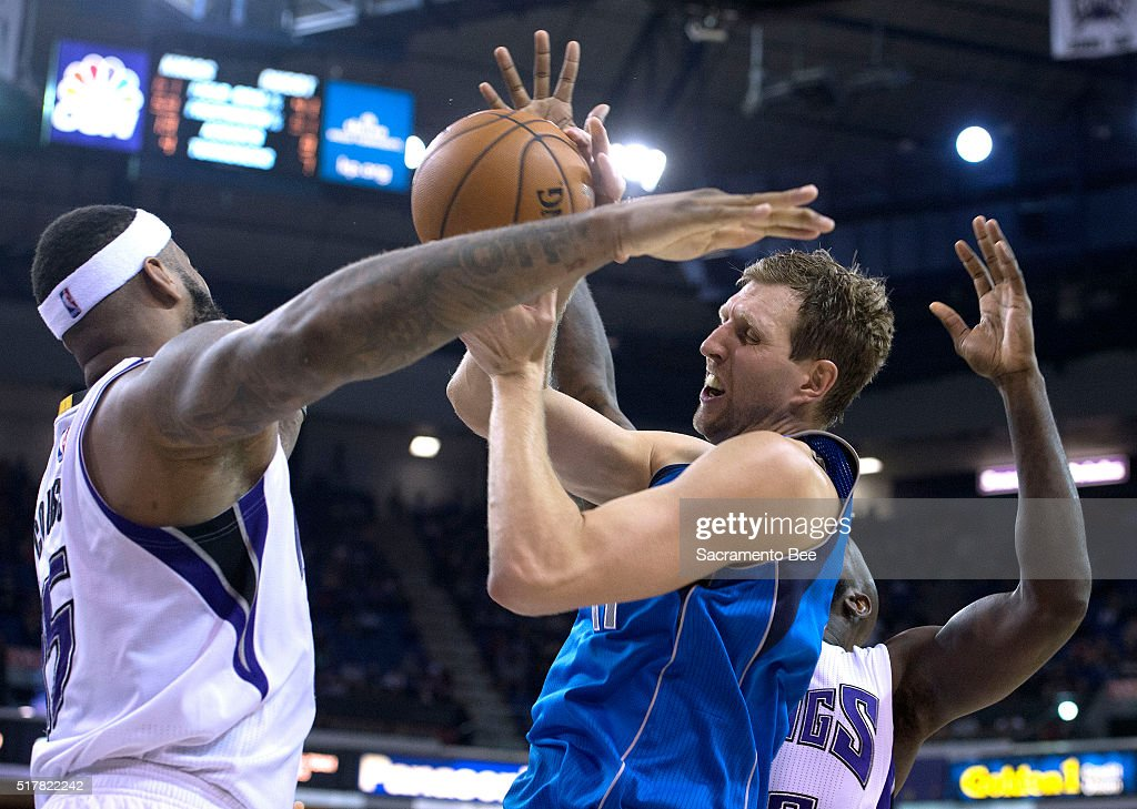 Dallas Mavericks forward Dirk Nowitzki (41) is fouled by Sacramento Kings center DeMarcus Cousins (15) during the third quarter on Sunday, March 27, 2016, at Sleep Train Arena in Sacramento, Calif.
