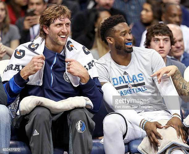 Dallas Mavericks forward Dirk Nowitzki left and guard Wesley Matthews sit on the bench as the Mavericks cruise to victory over the Los Angeles Lakers...