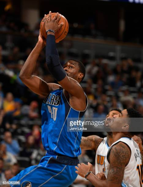 Dallas Mavericks forward Harrison Barnes goes up for a shot on Denver Nuggets guard Gary Harris during the third quarter February 6 2017 at Pepsi...