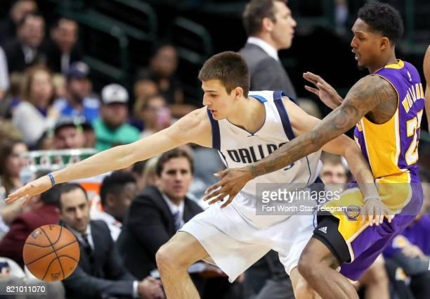 Dallas Mavericks forward Nicolas Brussino left is defended by Los Angeles Lakers guard Lou Williams on January 22 at the American Airlines Center in...