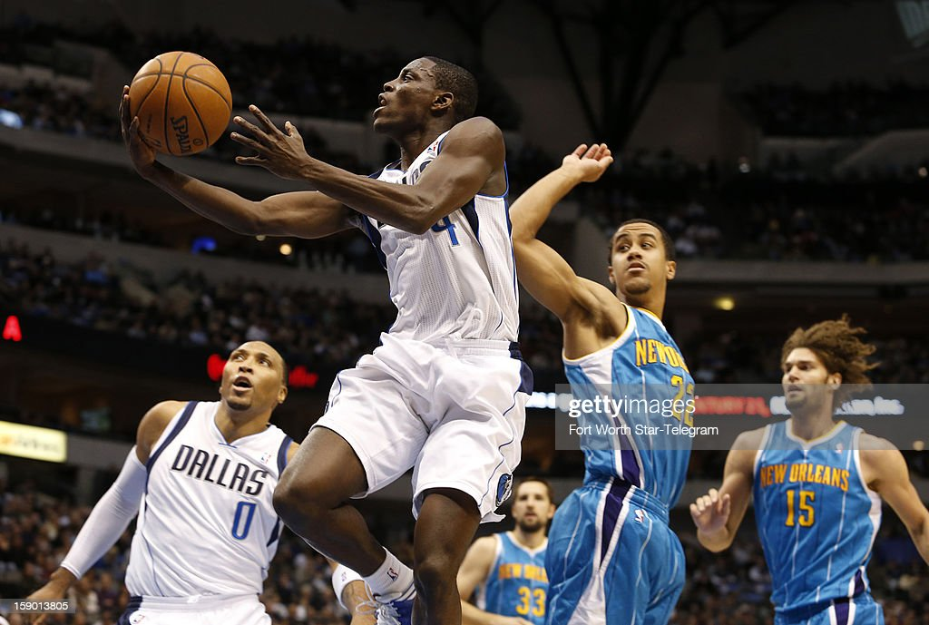 Dallas Mavericks guard Darren Collison puts up a shot past New Orleans Hornets defender Brian Roberts in the first half at the American Airlines...