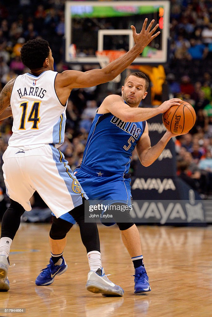 Dallas Mavericks guard J.J. Barea (5) looks to make a pass around Denver Nuggets guard <a gi-track='captionPersonalityLinkClicked' href=/galleries/search?phrase=Gary+Harris+-+Basketball+Player&family=editorial&specificpeople=10612733 ng-click='$event.stopPropagation()'>Gary Harris</a> (14) during the fourth quarter March 28, 2016 at Pepsi Center.