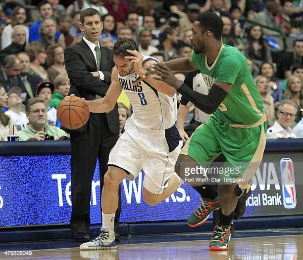 Dallas Mavericks guard Jose Calderon drives down court against Boston Celtics forward Jeff Green during the first period in Dallas Texas on Monday...