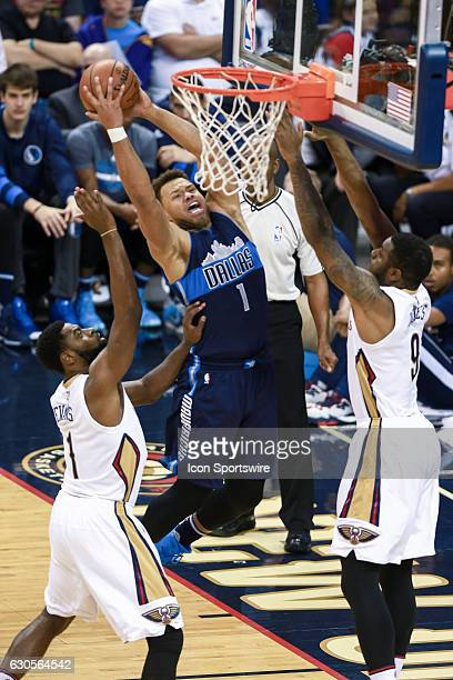 Dallas Mavericks guard Justin Anderson drives to the basket against New Orleans Pelicans forward Terrence Jones during the game between the New...