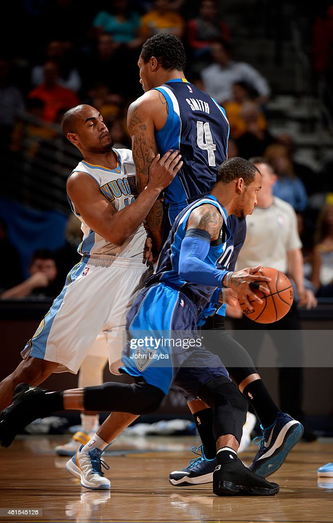 Dallas Mavericks guard <a gi-track='captionPersonalityLinkClicked' href=/galleries/search?phrase=Monta+Ellis&family=editorial&specificpeople=567403 ng-click='$event.stopPropagation()'>Monta Ellis</a> (11) makes a move to the basket as Denver Nuggets guard <a gi-track='captionPersonalityLinkClicked' href=/galleries/search?phrase=Arron+Afflalo&family=editorial&specificpeople=640861 ng-click='$event.stopPropagation()'>Arron Afflalo</a> (10) runs in to Dallas Mavericks forward <a gi-track='captionPersonalityLinkClicked' href=/galleries/search?phrase=Greg+Smith+-+Basketballer+-+Center&family=editorial&specificpeople=11490234 ng-click='$event.stopPropagation()'>Greg Smith</a> (4) during the first quarter January 14, 2015 at Pepsi Center.