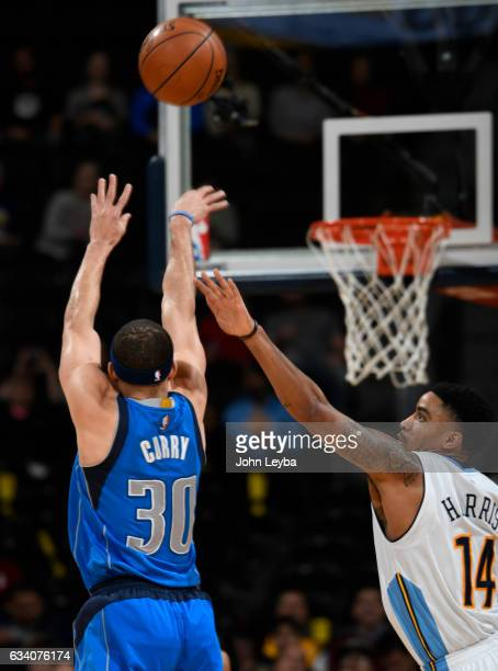Dallas Mavericks guard Seth Curry takes a shot over Denver Nuggets guard Gary Harris during the first quarter February 6 2017 at Pepsi Center