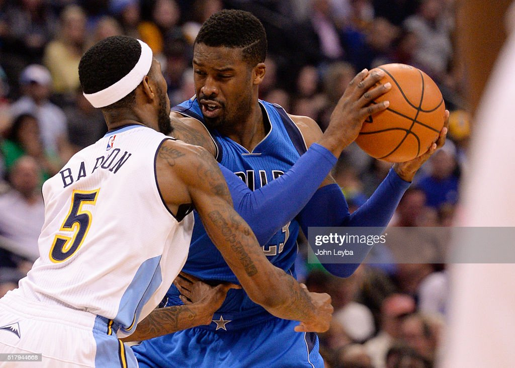 Dallas Mavericks guard <a gi-track='captionPersonalityLinkClicked' href=/galleries/search?phrase=Wesley+Matthews+-+Basketball+Player&family=editorial&specificpeople=804816 ng-click='$event.stopPropagation()'>Wesley Matthews</a> (23) gets guarded by Denver Nuggets forward <a gi-track='captionPersonalityLinkClicked' href=/galleries/search?phrase=Will+Barton&family=editorial&specificpeople=6894020 ng-click='$event.stopPropagation()'>Will Barton</a> (5) during the fourth quarter March 28, 2016 at Pepsi Center.