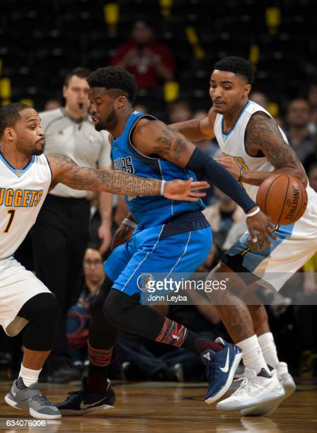 Dallas Mavericks guard Wesley Matthews gets the ball poked away by Denver Nuggets guard Jameer Nelson during the first quarter February 6 2017 at...
