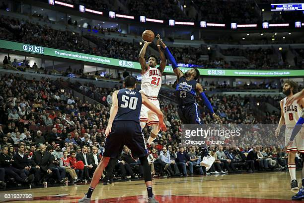 Dallas Mavericks guard Wesley Matthews guards Chicago Bulls forward Jimmy Butler while he takes a shot during the first half at the United Center...