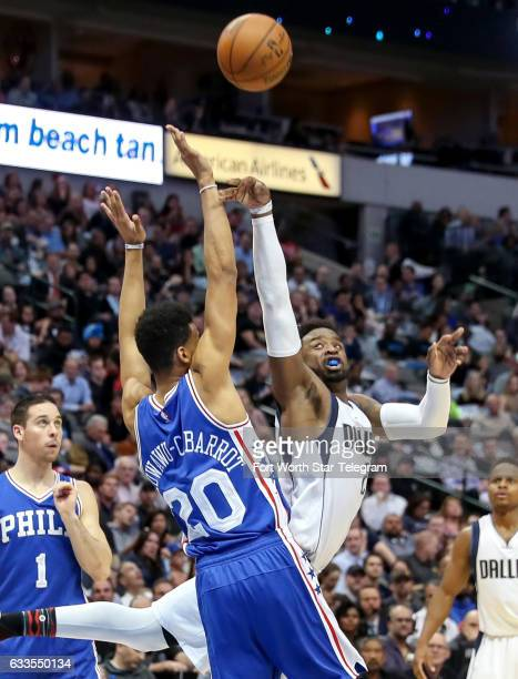Dallas Mavericks guard Wesley Matthews right gets fouled by Philadelphia 76ers guard Timothe LuwawuCabarrot during the first half on Wednesday Feb 1...