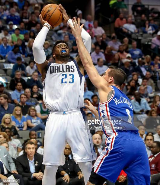Dallas Mavericks guard Wesley Matthews tries to get a shot off over Philadelphia 76ers guard TJ McConnell during the first half on Wednesday Feb 1...