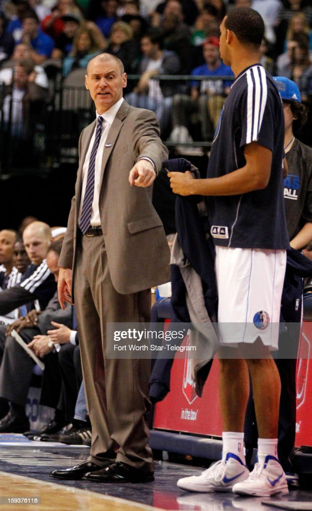 Dallas Mavericks head coach Rick Carlisle talks with Mavericks center Brandan Wright (34) during an attempted substitution in the fourth quarter against the Memphis Grizzlies at the American Airlines Arena in Dallas, Texas, Saturday, January 12, 2013. The Mavericks beat the Grizzlies, 104-83.