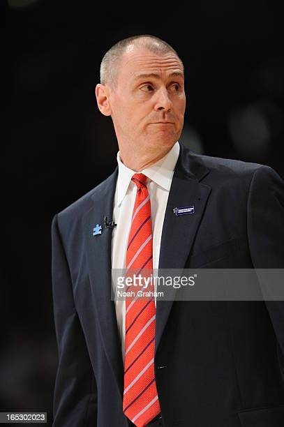 Dallas Mavericks head coach Rick Carlisle wears a blue lapel pin in honor of Autism Awareness at Staples Center on April 2 2013 in Los Angeles...