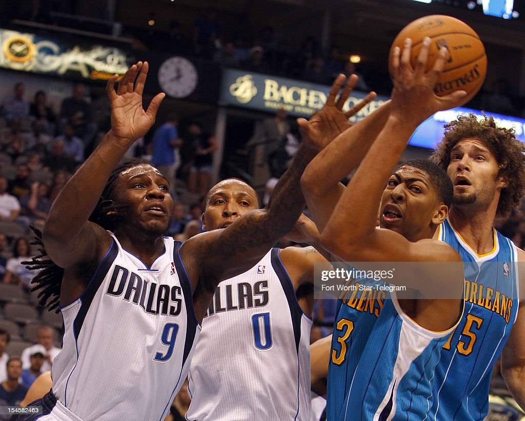 Dallas Mavericks Jae Crowder (9) and Shawn Marion (0) try for the rebound against New Orleans Hornets Anthony Davis (23) and Robin Lopez (15) at American Airlines Center Monday October 22, 2012, in Dallas, Texas.