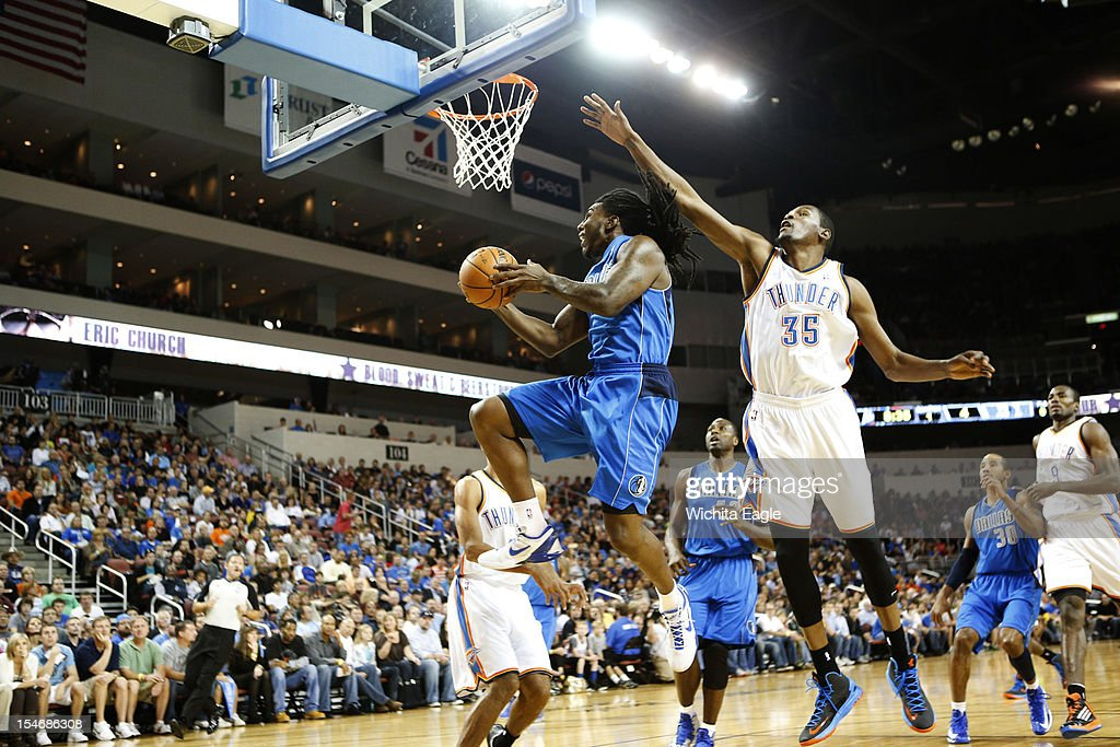 Dallas Mavericks' Jae Crowder makes a basket past Oklahoma City Thunder's Kevin Durant during their exhibition game at Intrust Bank Arena in Wichita, Kansas on Wednesday, October 24, 2012.