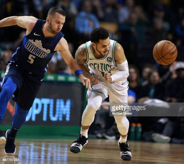 Dallas Mavericks' JJ Barea left and the Celtics' Shane Larkin right chase a first half loose ball The Boston Celtics host the Dallas Mavericks in a...