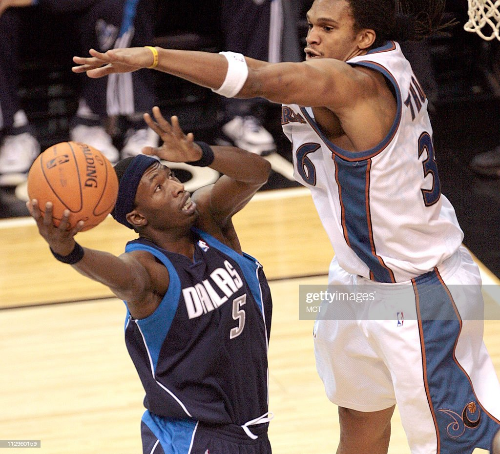 Dallas Mavericks Josh Howard 5 shoots as he is guarded clo