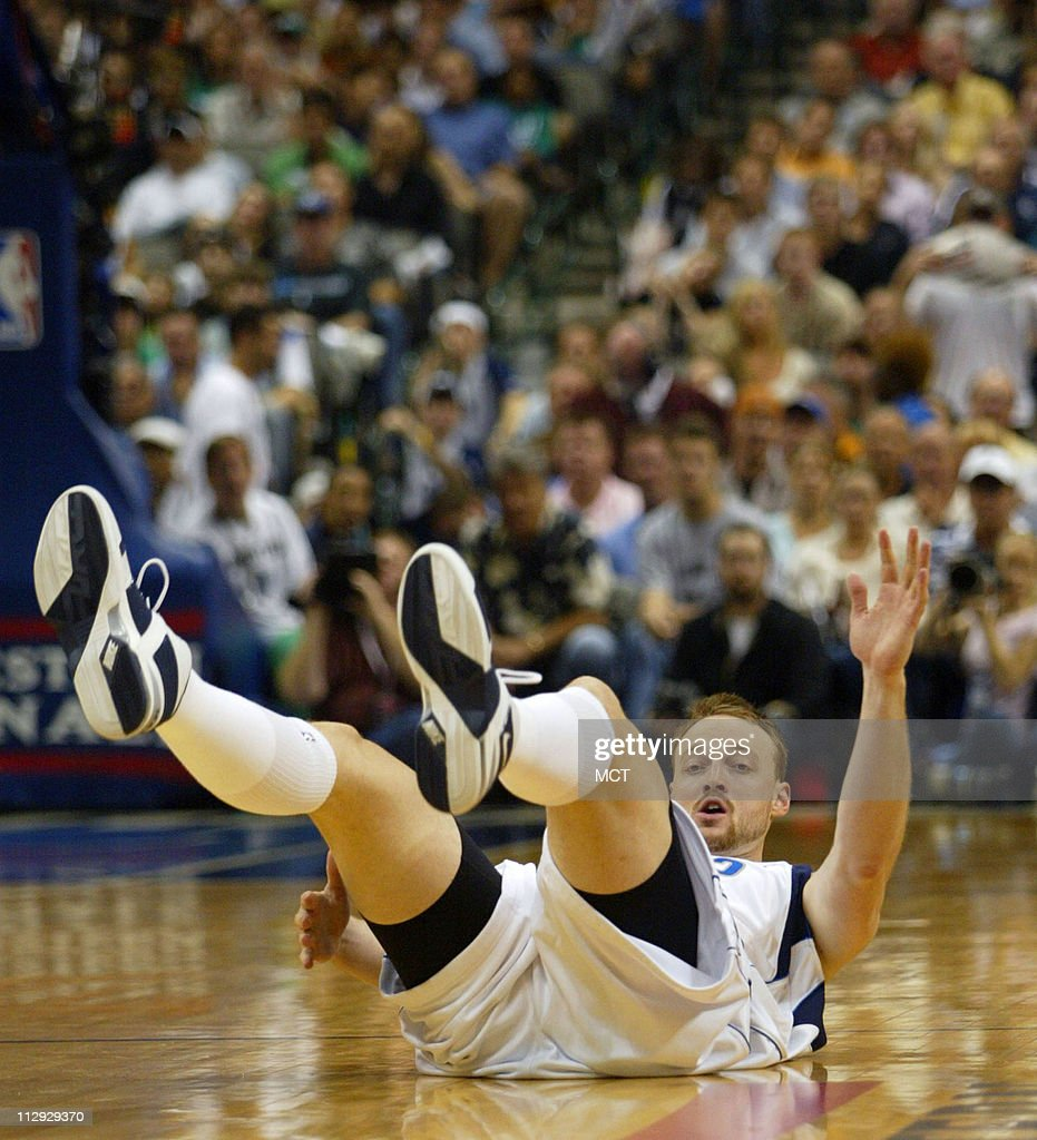 Dallas Mavericks Keith Van Horn takes a fall in the first a