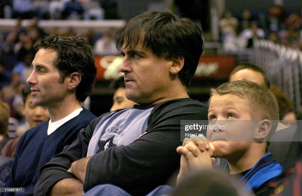 Dallas Mavericks owner Mark Cuban and a young Dallas fan watch during the Mavericks' 10192 loss to the Los Angeles Clippers at the Staples Center in...
