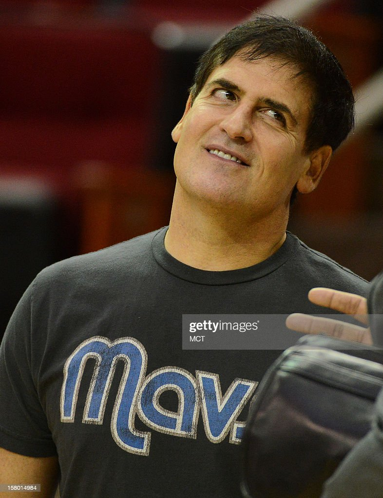 Dallas Mavericks' owner Mark Cuban talks on the court before his team faces the Houston Rockets on Saturday, December 8, 2012, in Houston, Texas.