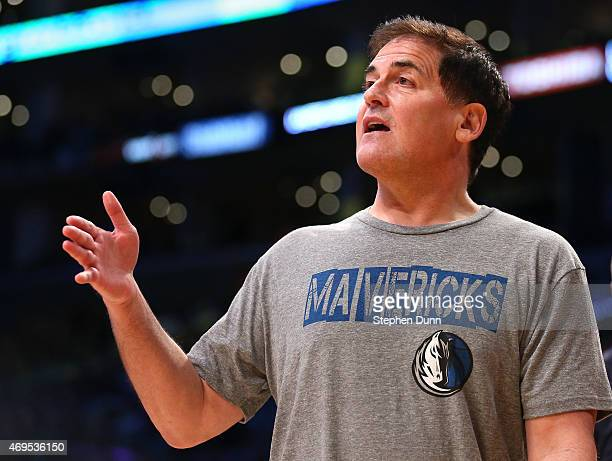 Dallas Mavericks owner Mark Cuban talks to a referee during a timeout in the game with the Los Angeles Lakers at Staples Center on April 12 2015 in...