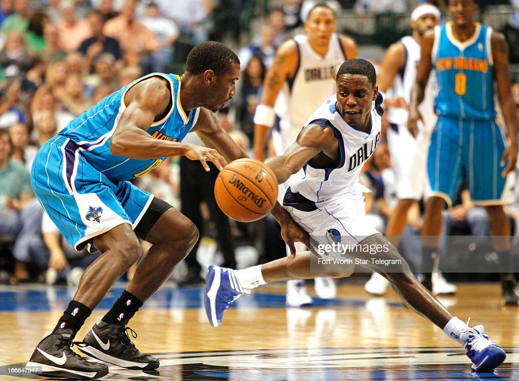 Dallas Mavericks point guard Darren Collison, right, steals the ball from New Orleans Hornets shooting guard Terrel Harris, left, on Wednesday April 17, 2013, in Dallas, Texas.