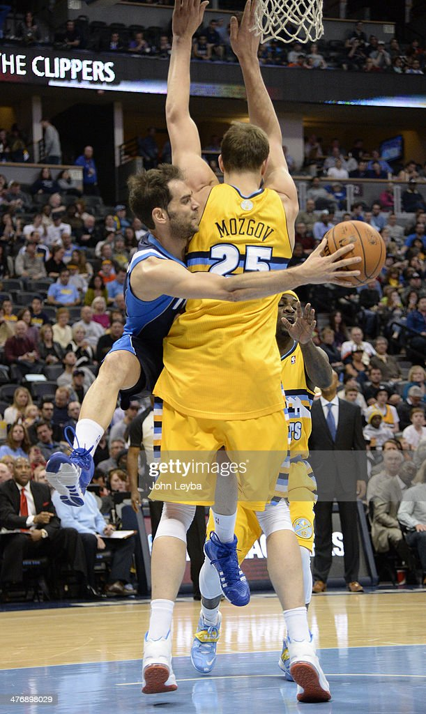Dallas Mavericks point guard Jose Calderon (8) makes a pass behind the back of Denver Nuggets center <a gi-track='captionPersonalityLinkClicked' href=/galleries/search?phrase=Timofey+Mozgov&family=editorial&specificpeople=3949705 ng-click='$event.stopPropagation()'>Timofey Mozgov</a> (25) March 5, 2014 at Pepsi Center. The Denver Nuggets defeated the Dallas Mavericks 115-110.