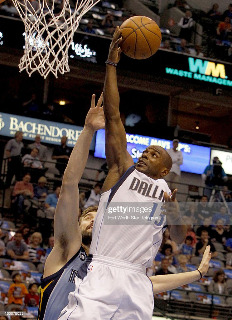 Dallas Mavericks point guard Mike James (13) puts up a shot over Memphis Grizzlies center Marc Gasol (33) during an NBA game at the American Airlines Center in Dallas, Texas, Monday, April 15, 2012.