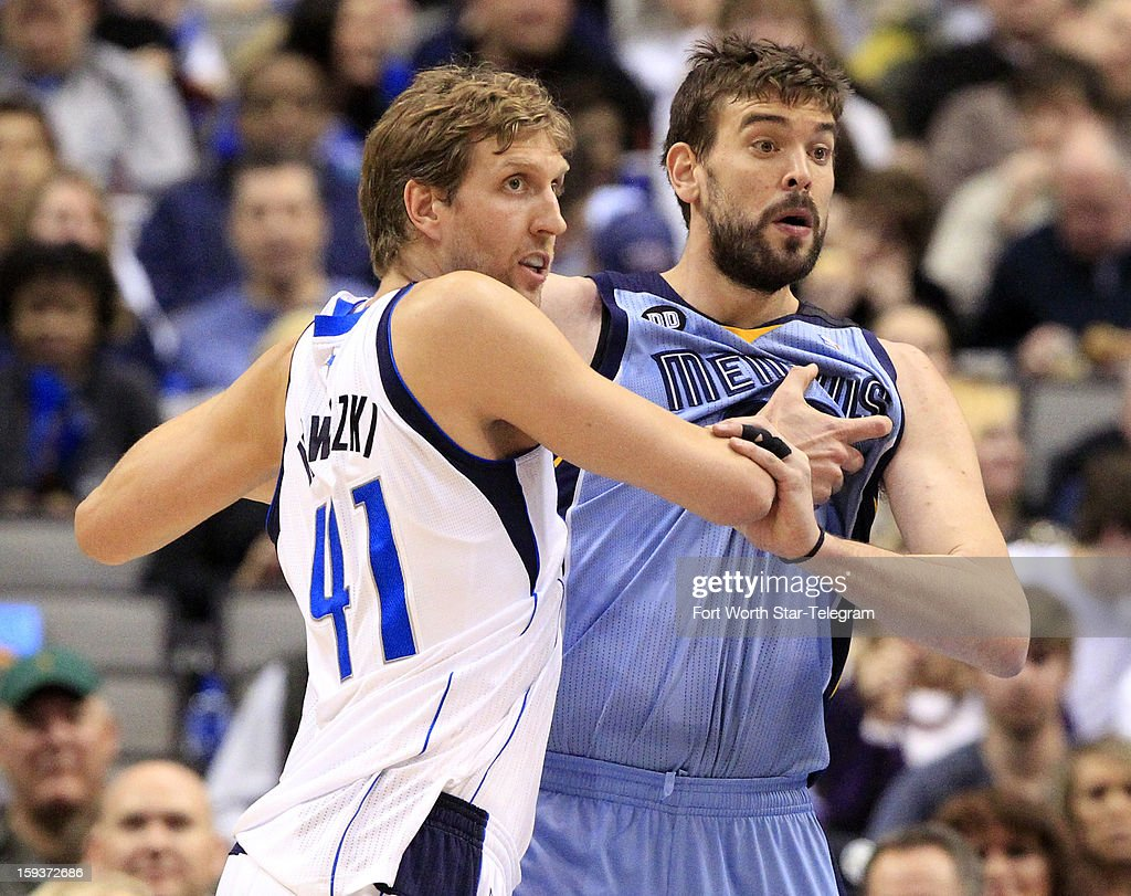 Dallas Mavericks power forward Dirk Nowitzki (41) and Memphis Grizzlies center Marc Gasol (33) wrestle for position during the second quarter at the American Airlines Arena in Dallas, Texas, Saturday, January 12, 2013.