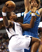 Dallas Mavericks power forward Dirk Nowitzki defends as New Orleans Hornets power forward Ryan Anderson launches a threepoint shot on Wednesday April...