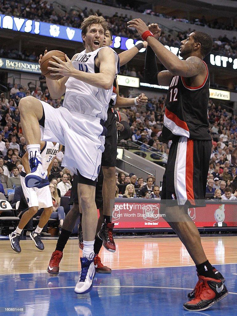 Dallas Mavericks power forward Dirk Nowitzki (41) rebounds in the first half against Portland Trail Blazers power forward LaMarcus Aldridge (12) in Dallas, Texas, Wednesday, February 6, 2013. The Mavericks defeated the Trail Blazers, 105-99.