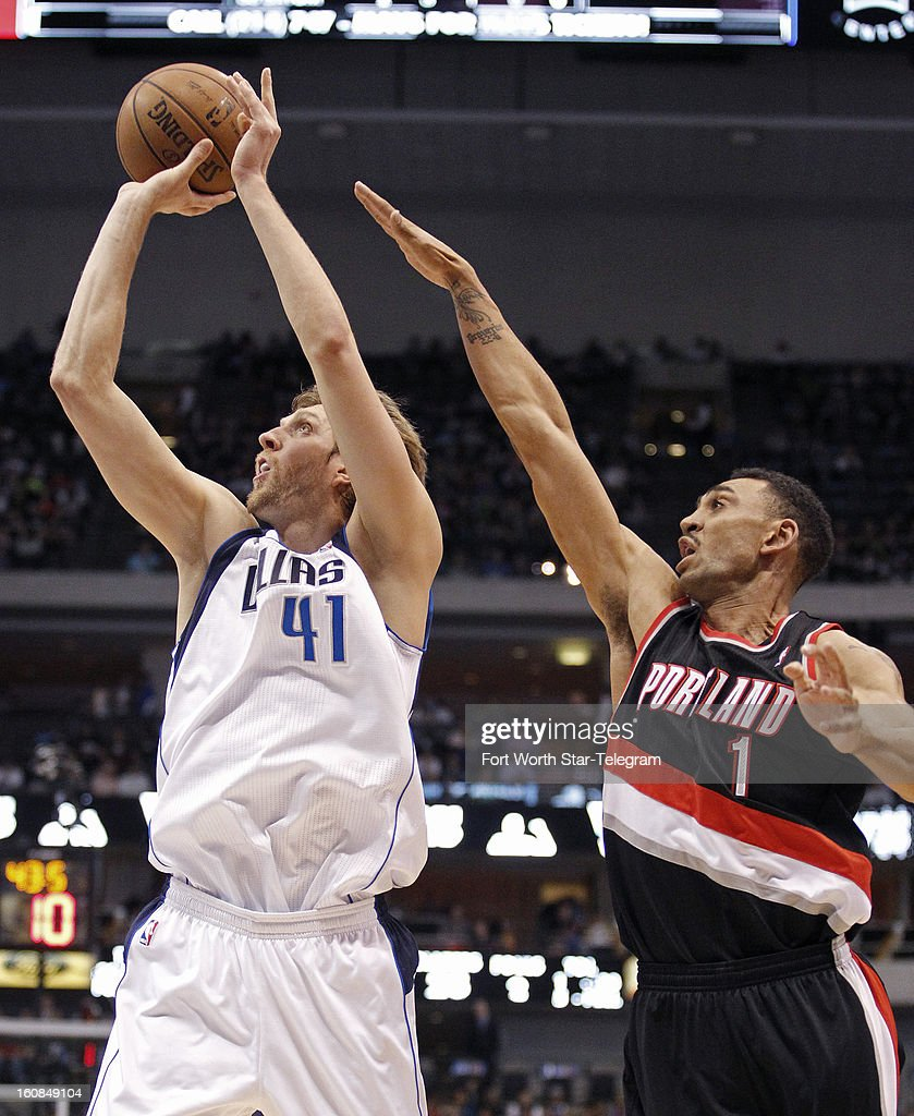 Dallas Mavericks power forward Dirk Nowitzki (41) shoots against Portland Trail Blazers power forward Jared Jeffries (1) during the first period in Dallas, Texas, Wednesday, February 6, 2013.