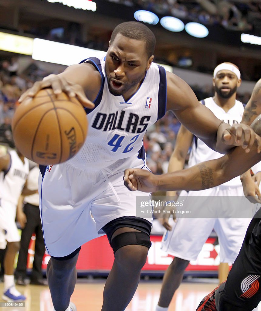 Dallas Mavericks power forward Elton Brand (42) lunges for a loose ball in the second quarter against the Portland Trail Blazers in Dallas, Texas, Wednesday, February 6, 2013.