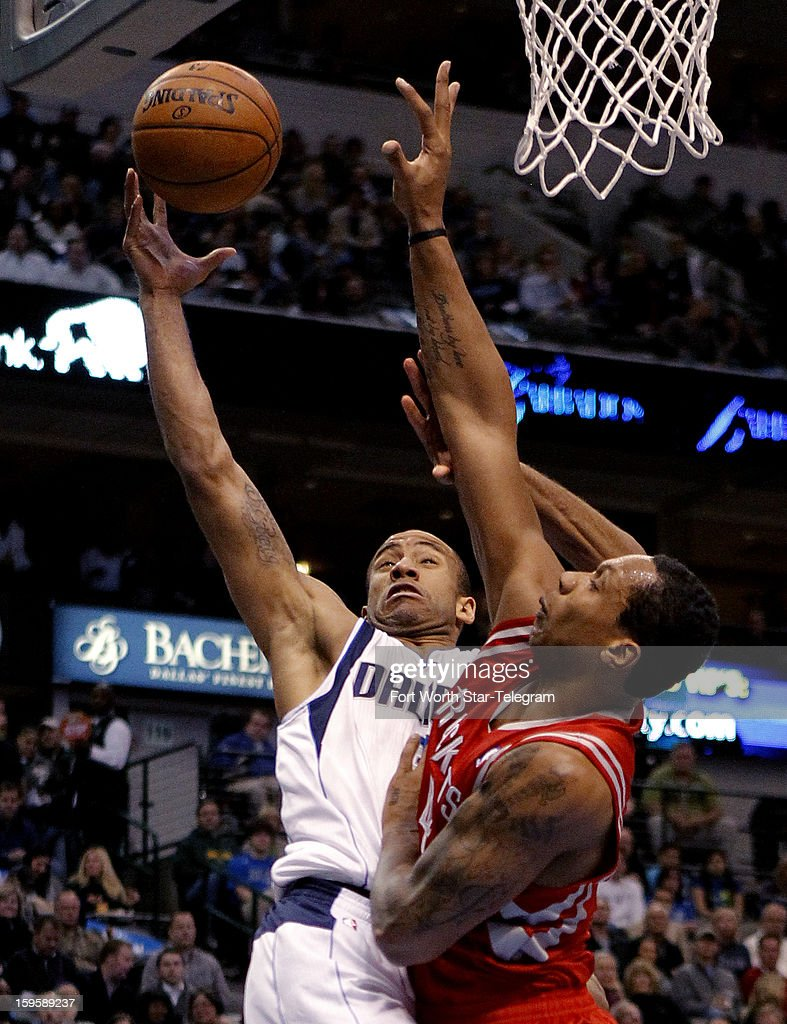 Dallas Mavericks shooting guard Dahntay Jones (30) drives to the basket against Houston Rockets power forward Greg Smith (4) during the second quarter at the American Airlines Center on Wednesday, January 16, 2013, in Dallas, Texas.