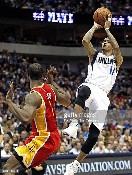 Dallas Mavericks shooting guard Monta Ellis shoots over Houston Rockets power forward Terrence Jones at the American Airlines Center in Dallas on...