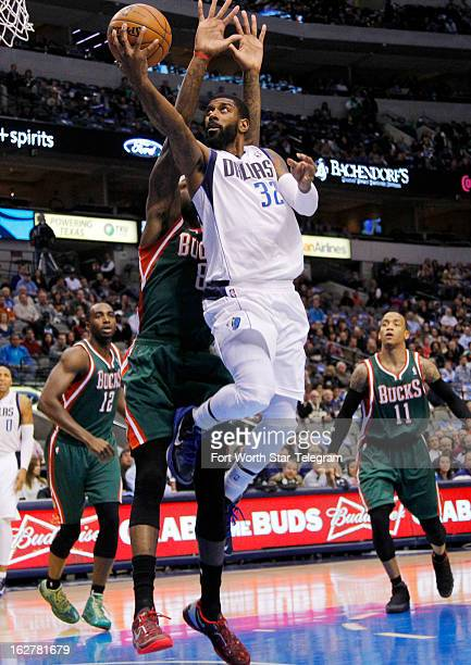 Dallas Mavericks shooting guard OJ Mayo drives around Milwaukee Bucks center Larry Sanders for a shot in the first half at American Airlines Center...