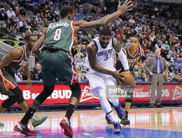 Dallas Mavericks shooting guard OJ Mayo drives under Milwaukee Bucks center Larry Sanders for a shot in the first half at American Airlines Center in...