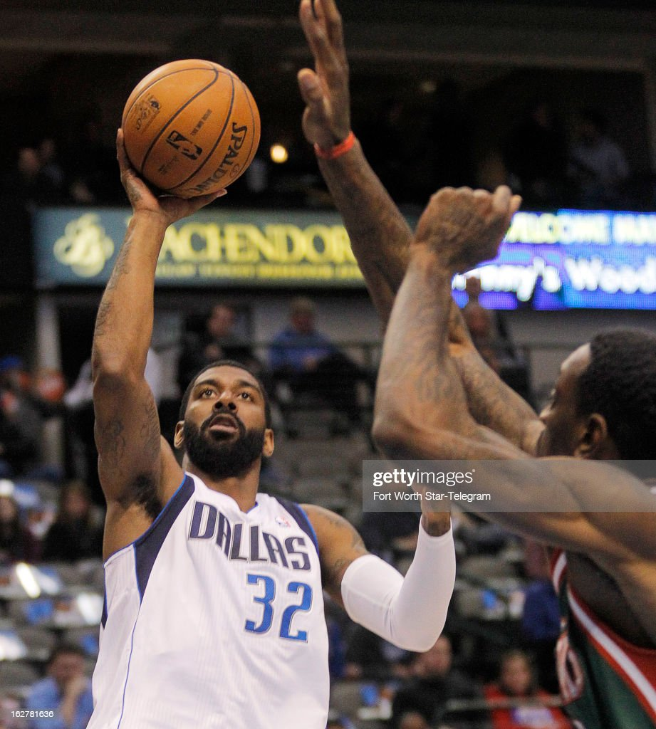 Dallas Mavericks shooting guard O.J. Mayo (32) goes up for a shot against the Milwaukee Bucks in the first half at American Airlines Center in Dallas, Texas, Tuesday, February 26, 2013. The Bucks defeated the Mavericks, 95-90.