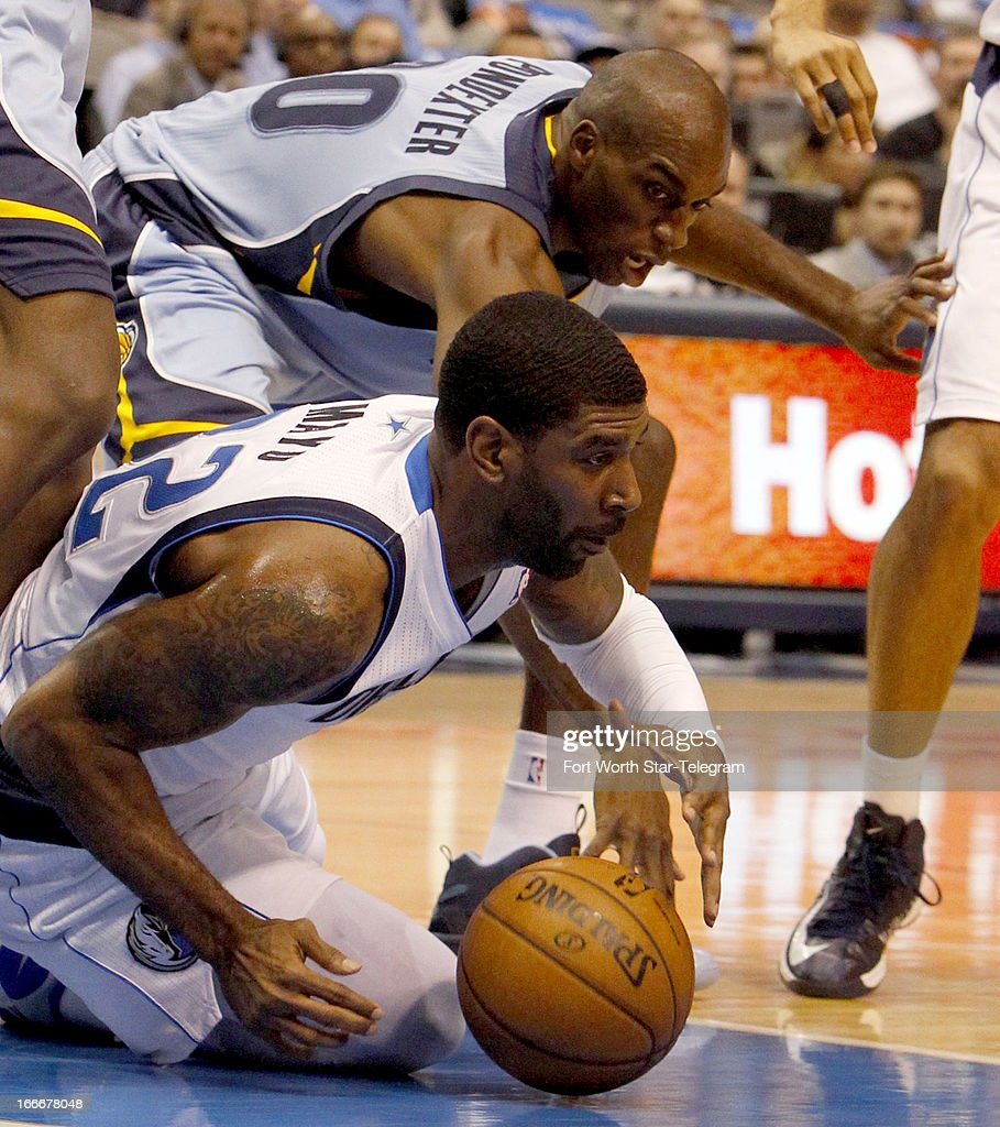 Dallas Mavericks shooting guard O.J. Mayo (32) tries to keep the ball from Memphis Grizzlies small forward Quincy Pondexter (20) during an NBA game at the American Airlines Center in Dallas, Texas, Monday, April 15, 2012.
