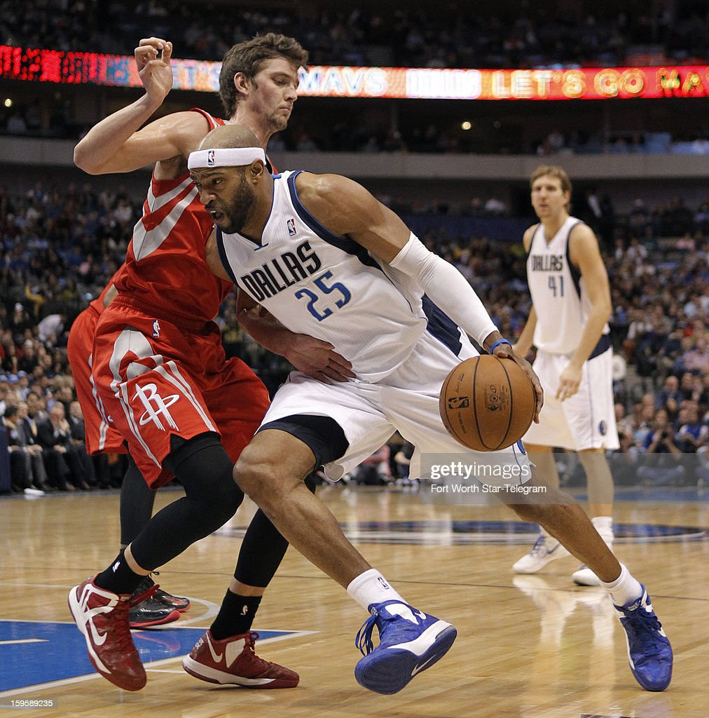 Dallas Mavericks shooting guard Vince Carter (25) drives to the bucket against Houston Rockets small forward Chandler Parsons (25) during the first half at the American Airlines Center on Wednesday, January 16, 2013, in Dallas, Texas.