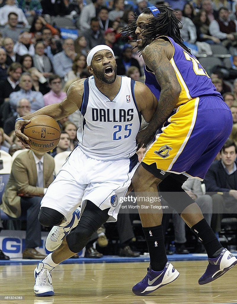 Dallas Mavericks shooting guard Vince Carter gets fouled by Los Angeles Lakers center Jordan Hill during the first half Tuesday January 7 at the...