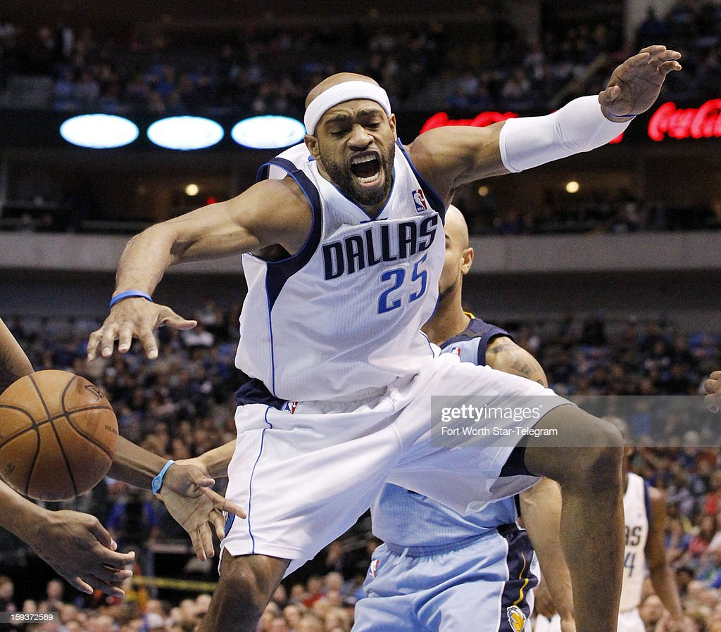 Dallas Mavericks shooting guard Vince Carter (25) loses the basketball in heavy traffic during the first quarter against the Memphis Grizzlies at the American Airlines Arena in Dallas, Texas, Saturday, January 12, 2013.