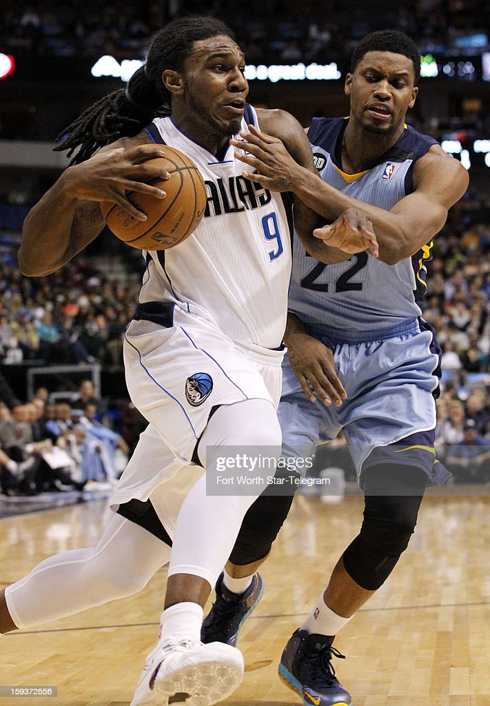 Dallas Mavericks small forward Jae Crowder (9) tries to get around Memphis Grizzlies small forward Rudy Gay (22) in the second quarter at the American Airlines Arena in Dallas, Texas, Saturday, January 12, 2013.